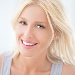 Blonde haired woman with blue eyes smiling