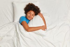 Woman soundly sleeping with sleep apnea