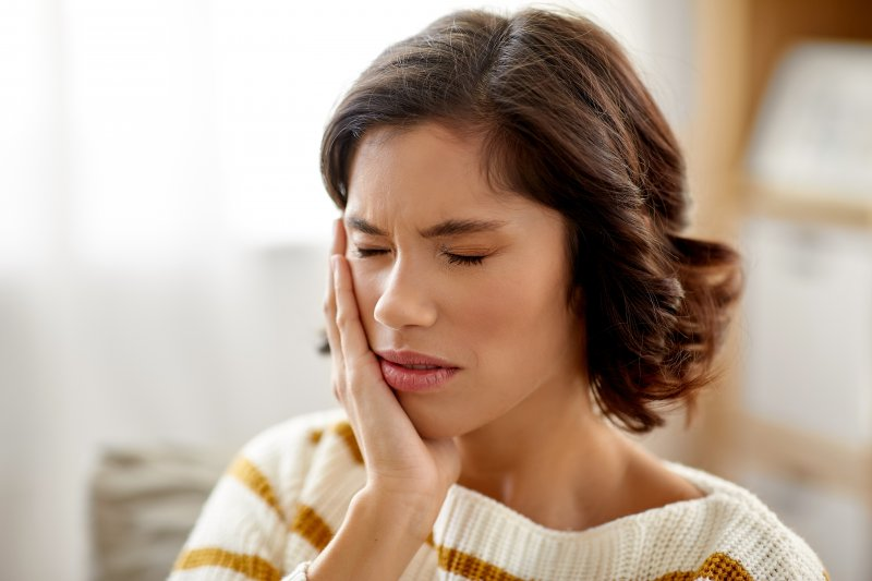 Closeup of woman experiencing tooth pain