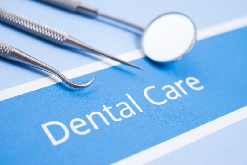 """dental instruments and paperwork reading """"Dental Care"""""""